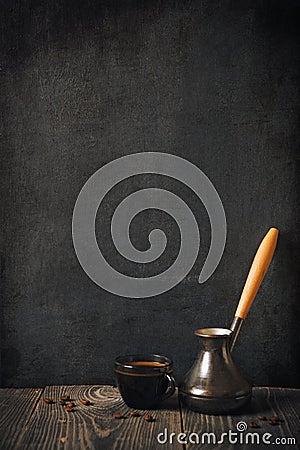 Cup of coffee on blackboard