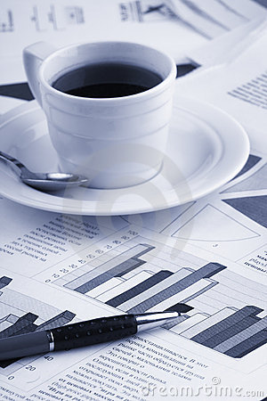 Cup coffee on business news
