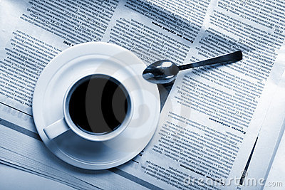 Cup coffee on  business news
