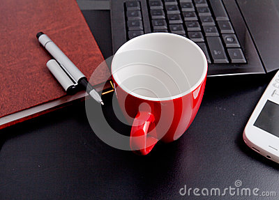 Cup of coffee and business objects