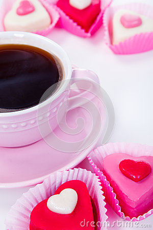 Cup with coffee and candies