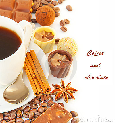 Cup of coffee with chocolates, coffee grains with