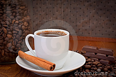 Cup of coffee, cinnamon and chocolate