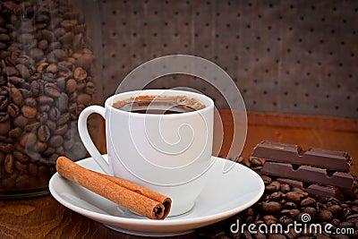 Cup of coffee, cinnamon and chocolate