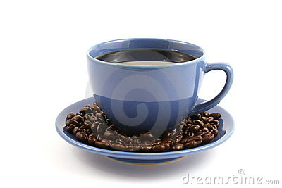 Cup of coffee with coffee beans on plate