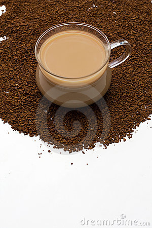 Cup of coffee and coffee powder as background
