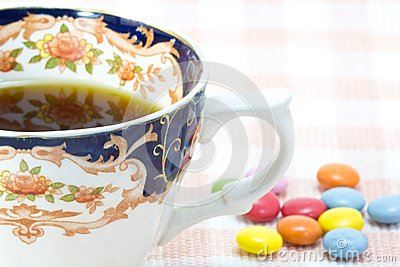 Cup of coffee and colorful chocolate