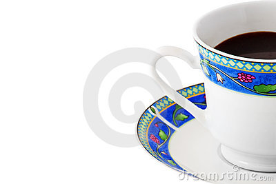Cup of coffee in a colorful plate on white