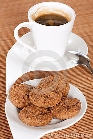 Cup with coffee and cookies