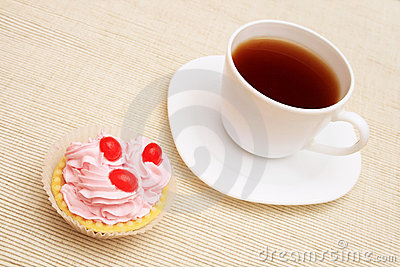 Cup of coffee and cupcake.