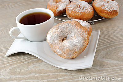 A cup of coffee and donuts