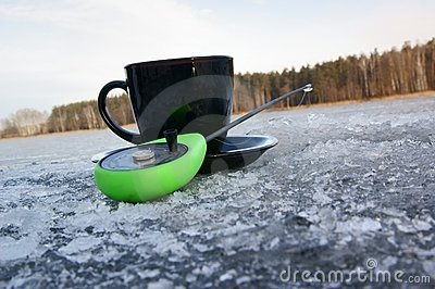 Cup of coffee and fishing rod