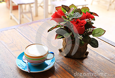 A cup of coffee with flower