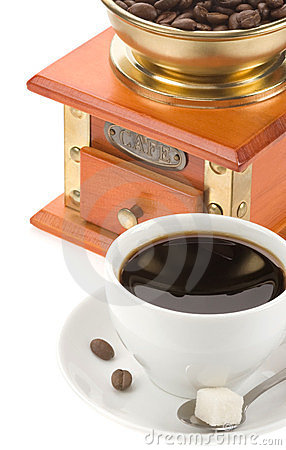 Cup of coffee and grinder with beans