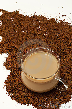Cup of coffee on Instant coffee powder background