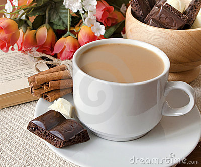 Cup of coffee with milk and chocolate