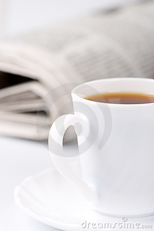 Cup of coffee and newspapers
