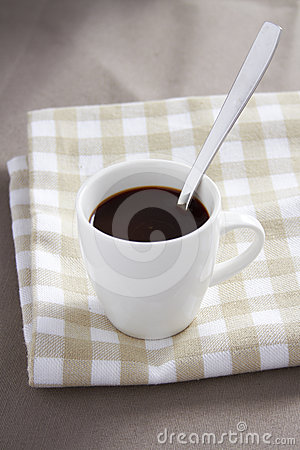 Cup of coffee onl tablecloth