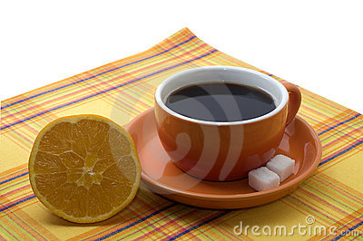 Cup of coffee with an orange
