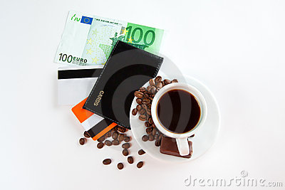 A cup of coffee,  seeds, candy and money