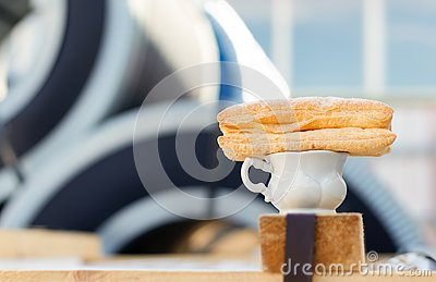 A Cup of coffee and a sweet bun in the workplace Stock Photo