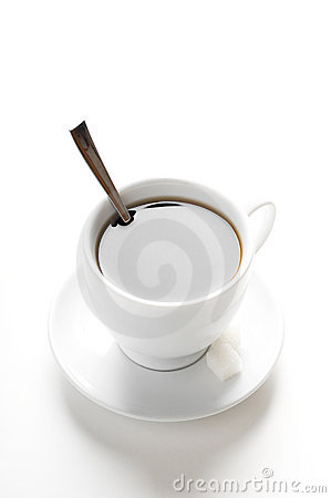 Cup of coffee with teaspoon and sugar slices