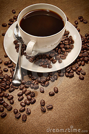 Cup of coffee on wood background