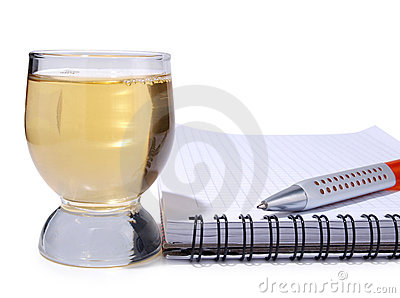 Cup and empty notebook