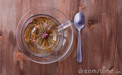 Cup of green tea with teaspoon