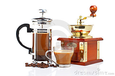Cup, grinder, coffee pot and beans