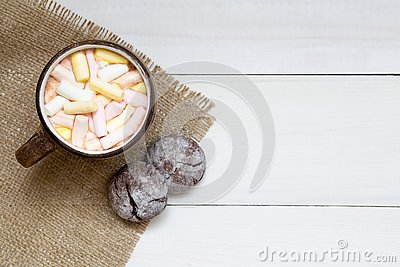 Cup of hot cocoa with marshmallows and cookies on white table, top view, copy space Stock Photo