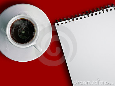 Cup of hot coffe and notebook