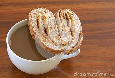 Cup of hot coffee and palmier cookie