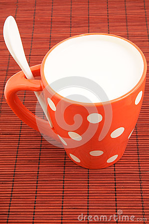 Cup of milk on placemat
