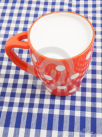 Cup of milk on tablecloth