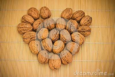 Cup of nuts on bamboo table cloth