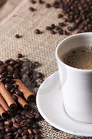 Free Cup Of Coffee With Cinnamon And Coffee Grains Stock Photo - 18502320