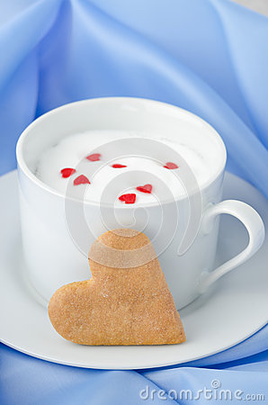 Free Cup Of Hot Milk With Foam, Decorated With Sugar Hearts And Heart Stock Photography - 28602482