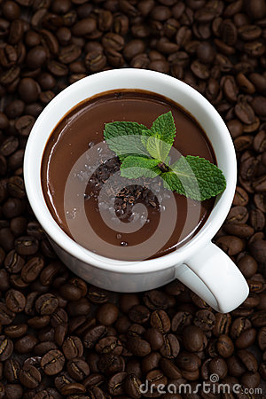 Free Cup Of Hot Mint Chocolate On The Background Of Coffee Beans Stock Photography - 76267432