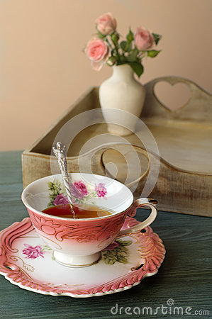 Free Cup Of Tea On A Background Of Flowers In A Vase Royalty Free Stock Photo - 55131905