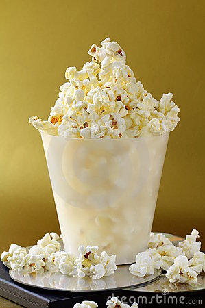 Cup of popcorn and DVD disks