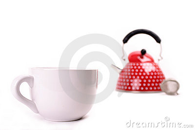 Cup and red teapot
