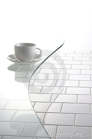 Cup and saucer on glass table