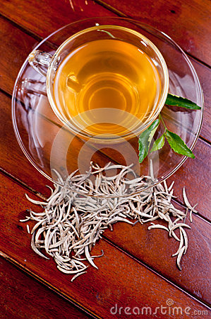 Cup of silver tips tea on a wooden table