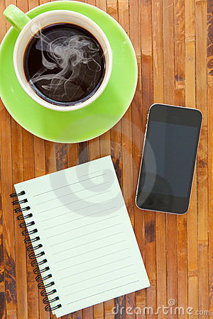 Cup smartphone and book