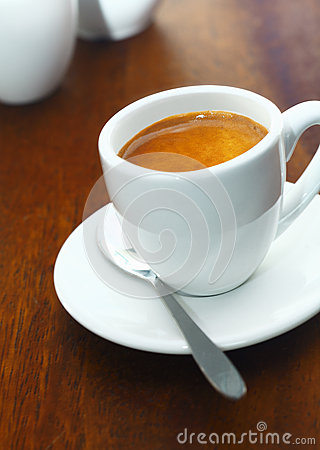 Cup of strong aromatic espresso coffee