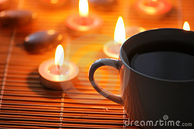 Cup of tea and aromatic candle