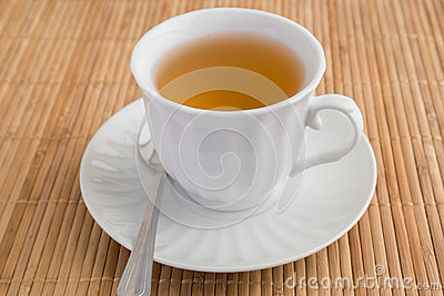 A cup of tea on bamboo mat