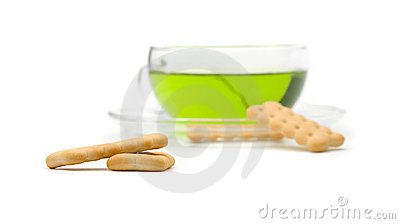 A cup of tea and biscuits (focus on biscuits)