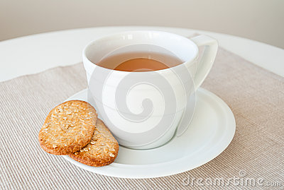 Cup of tea with cereal biscuits
